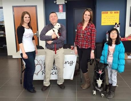 Bethany and Donna with Two Dogs Receiving a Generous Donation by Subaru of Moncton